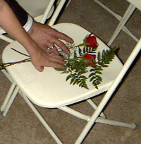 Two roses on an empty chair