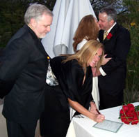 Matron of Honor & Best Man sign the license