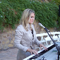 Music by Theresa Coe, Vocalist/Pianist