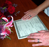 The rings & marriage license